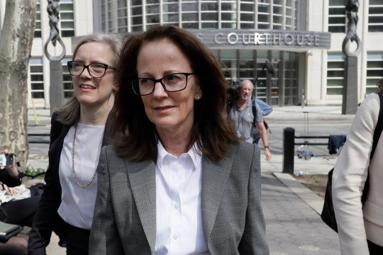 Kathy Russell, a member of NXIVM, an organization charged with sex trafficking, leaves Brooklyn Federal Court, Monday, April 8, 2019, in New York. Jury selection is set to begin Monday for the trial, expected to detail sensational allegations that a cult-like group based in upstate New York recruited sex slaves for its spiritual leader.