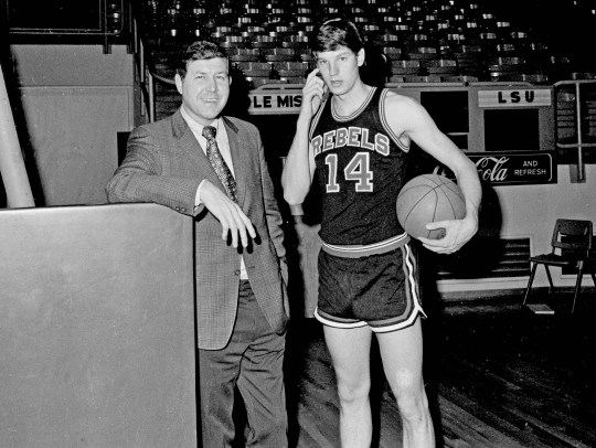 Ole Miss Rebels basketball coach Cob Jarvis, left, poses with his star player Johnny Neumann during a practice session at the University of Mississippi campus in Oxford, March 12, 1971. (AP Photo)