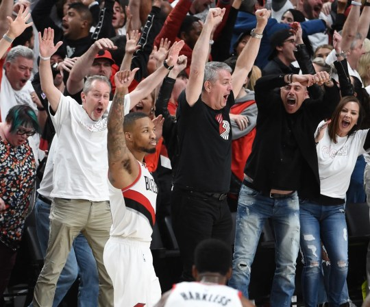 Damian Lillard and fans react after his game-winning buzzer-beater.