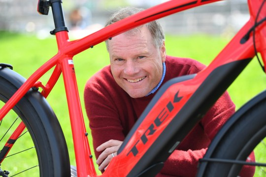 John Burke, CEO of Trek Bicycle, with their new e-Bicycle the Super Commuter +8s.