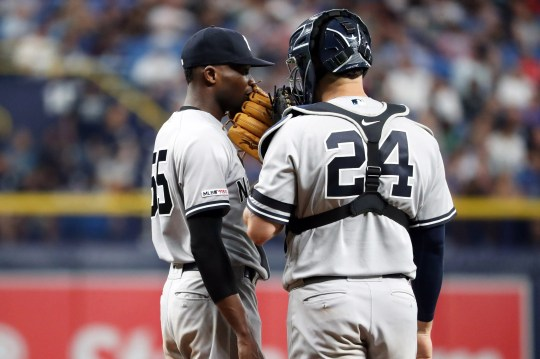 New York Yankees starting pitcher Domingo German (55) talks to catcher Gary Sanchez (24) during the fifth inning against the Tampa Bay Rays at Tropicana Field.