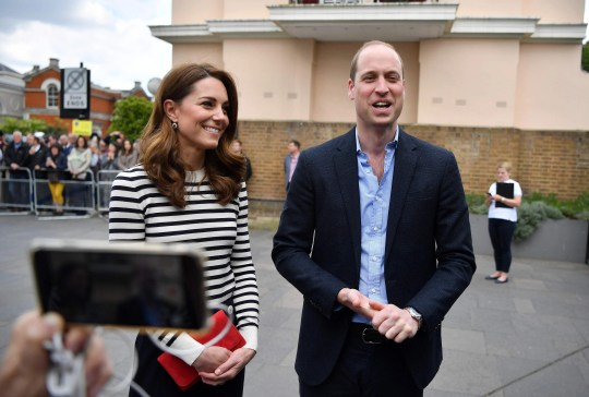 Prince William and Duchess Kate of Cambridge talk to reporters about their delight over their newborn nephew as they arrive to launch the King's Cup Regatta at the Cutty Sark in Greenwich, south-east London on May 7, 2019.