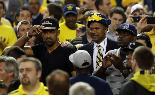 Former Michigan Fab Five stars Juwan Howard, left, and Jalen Rose greet MIchigan fans as they watch the Wolverines play Louisville during the 2013 NCAA championship game at the Georgia Dome on April 8, 2013 in Atlanta.