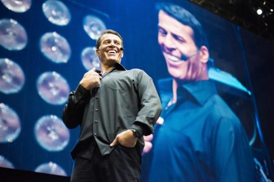 Tony Robbins speaks on stage during