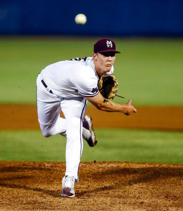 Mississippi State pitcher Brandon Smith watches a delivery to an LSU batter during the first inning of a Southeastern Conference tournament NCAA college baseball game Wednesday, May 22, 2019, in Hoover, Ala. (AP Photo/Butch Dill)