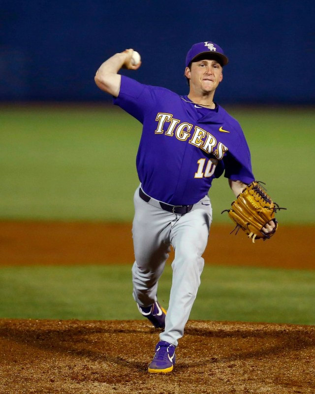 LSU's Eric Walker throws a pitch during the first inning against Mississippi State in a Southeastern Conference tournament NCAA college baseball game Wednesday, May 22, 2019, in Hoover, Ala. (AP Photo/Butch Dill)