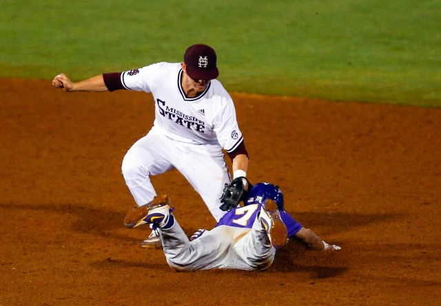 LSU's Giovanni DiGiacomo (7) is tagged out by Mississippi State shortstop Jordan Westburg (11) as he tries to steal second base during the 10th inning of the Southeastern Conference tournament NCAA college baseball game, Wednesday, May 22, 2019, in Hoover, Ala. (AP Photo/Butch Dill)