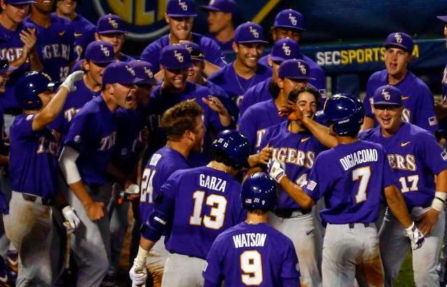 LSU's Giovanni DiGiacomo (7) celebrates with his team after hitting a two run homer during the eighth inning of the Southeastern Conference tournament NCAA college baseball game against Mississippi State, Wednesday, May 22, 2019, in Hoover, Ala. (AP Photo/Butch Dill)
