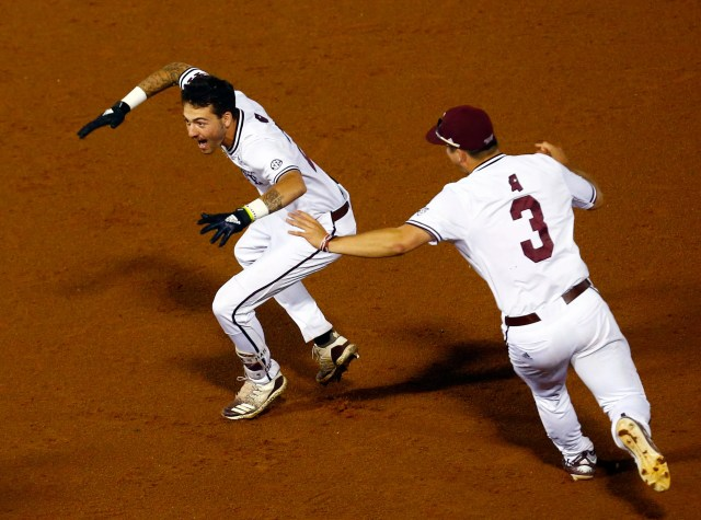 Mississippi State's Gunner Halter (2) celebrates with JT Ginn (3) after driving in the winning run during the 17th inning of the Southeastern Conference tournament NCAA college baseball game against LSU, early morning Thursday, May 23, 2019, in Hoover, Ala. State defeated LSU 6-5. (AP Photo/Butch Dill)