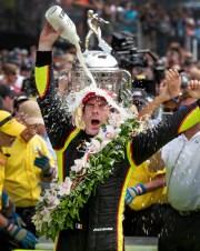 Simon Pagenaud of Team Penske celebrates winning the Indianapolis 500 at Indianapolis Motor Speedway on Sunday, May 26, 2019.