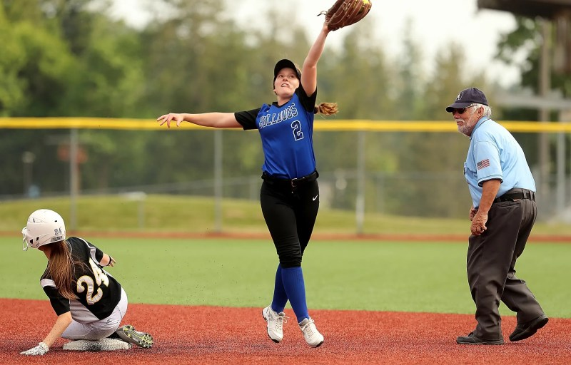 South Kitsap's Teanna Lathum (24) is safe at second as North Mason's Amber Johnson reaches up for the catch during the Kitsap Athletic Roundtable 17th Annual Softball Showcase All-Star Game at the fairgrounds on Wednesday, May 29, 2019.