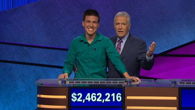 """""""Jeopardy!"""" host Alex Trebek, right, shares a moment with the brainy quiz show's recent long-running champ, James Holzhauer."""