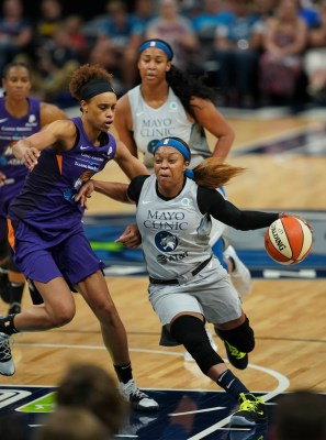 Minnesota Lynx guard Odyssey Sims drives around Phoenix Mercury forward Brianna Turner during the first quarter of a WNBA basketball game Thursday, June 6, 2019, in Minneapolis.