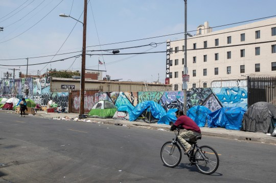 Homeless people and their tents line a Skid Row street in downtown Los Angeles in May.