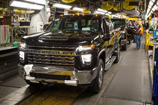 A full-size Chevrolet Silverado pickup truck is ready to exit the assembly line on June 12, 2019 at the Flint assembly plant. (Photo by Jeffrey Sauger for General Motors)