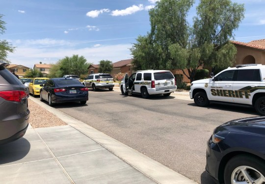 Patrol cars at the scene of an accidental shooting that left one dead in Tucson.