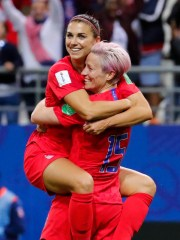 Alex Morgan, left, celebrates her fifth goal with forward Megan Rapinoe during the USWNT's 13-0 rout of Thailand on Tuesday.