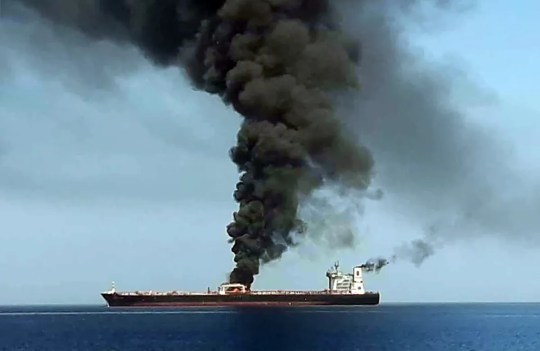 "TOPSHOT - A picture obtained by AFP from Iranian State TV IRIB on June 13, 2019 reportedly shows smoke billowing from a tanker said to have been attacked off the coast of Oman, at un undisclosed location. - The crews of two oil tankers were evacuated off the coast of Iran today after they were reportedly attacked and caught fire in the Gulf of Oman, sending world oil prices soaring. The mystery incident, the second involving shipping in the strategic sea lane in only a few weeks, came amid spiralling tensions between Tehran and Washington, which has pointed the finger at Iran over tanker attacks in May. Iran said its navy had rescued 44 crew members after the two vessels caught fire in ""accidents"" off its coast. (Photo by HO / IRIB TV / AFP) / == RESTRICTED TO EDITORIAL USE - MANDATORY CREDIT ""AFP PHOTO / HO / IRIB"" - NO MARKETING NO ADVERTISING CAMPAIGNS - DISTRIBUTED AS A SERVICE TO CLIENTS FROM ALTERNATIVE SOURCES, AFP IS NOT RESPONSIBLE FOR ANY DIGITAL ALTERATIONS TO THE PICTURE'S EDITORIAL CONTENT, DATE AND LOCATION WHICH CANNOT BE INDEPENDENTLY VERIFIED - NO RESALE -NO ACCESS lSRAEL MEDIA -PERSIAN LANGUAGE TV STATIONS OUTSIDE IRAN - STRICTLY NO ACCESS BBC PERSIAN == / HO/AFP/Getty Images ORIG FILE ID: AFP_1HH1VD"
