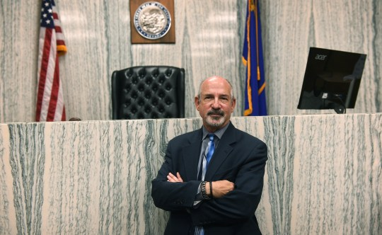Marc Picker, the Nevada Center for Civic Engagement's co-president, poses for a portrait in a courtroom in Reno on June 13, 2019.