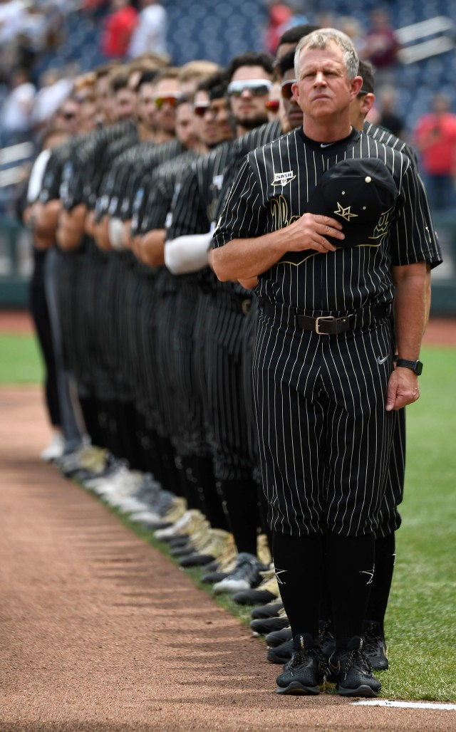 Vanderbilt, with coach Tim Corbin at the front, stands for the national anthem before the game against Mississippi State in the 2019 NCAA Men's College World Series at TD Ameritrade Park Wednesday, June 19, 2019, in Omaha, Neb.