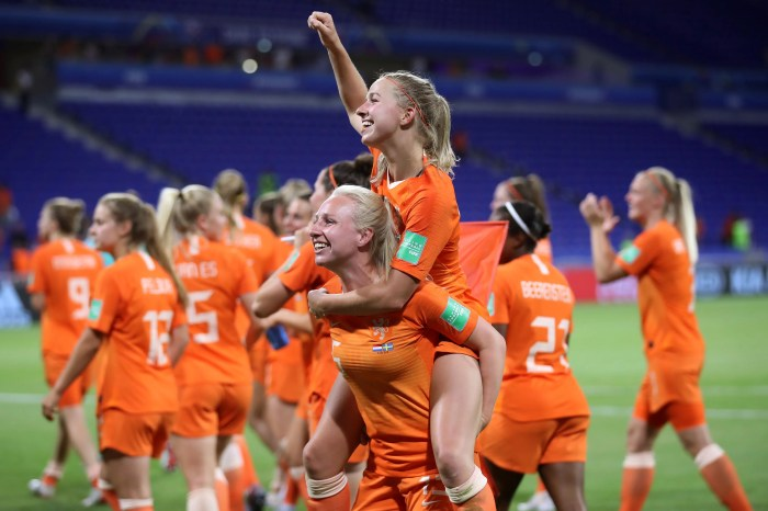 Jackie Groenen and Inessa Kaagman celebrate after the Netherlands defeated Sweden to reach the World Cup final.