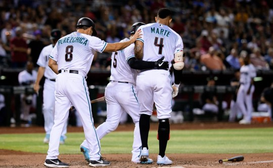 Ketel Marte #4 of the Arizona Diamondbacks is restrained by Eduardo Escobar #5 and third base coach Tony Perezchica #8 after striking out on a foul tip in the seventh inning of the MLB game against the Milwaukee Brewers at Chase Field on July 19, 2019 in Phoenix, Arizona. Ketel Marte was ejected from the game.