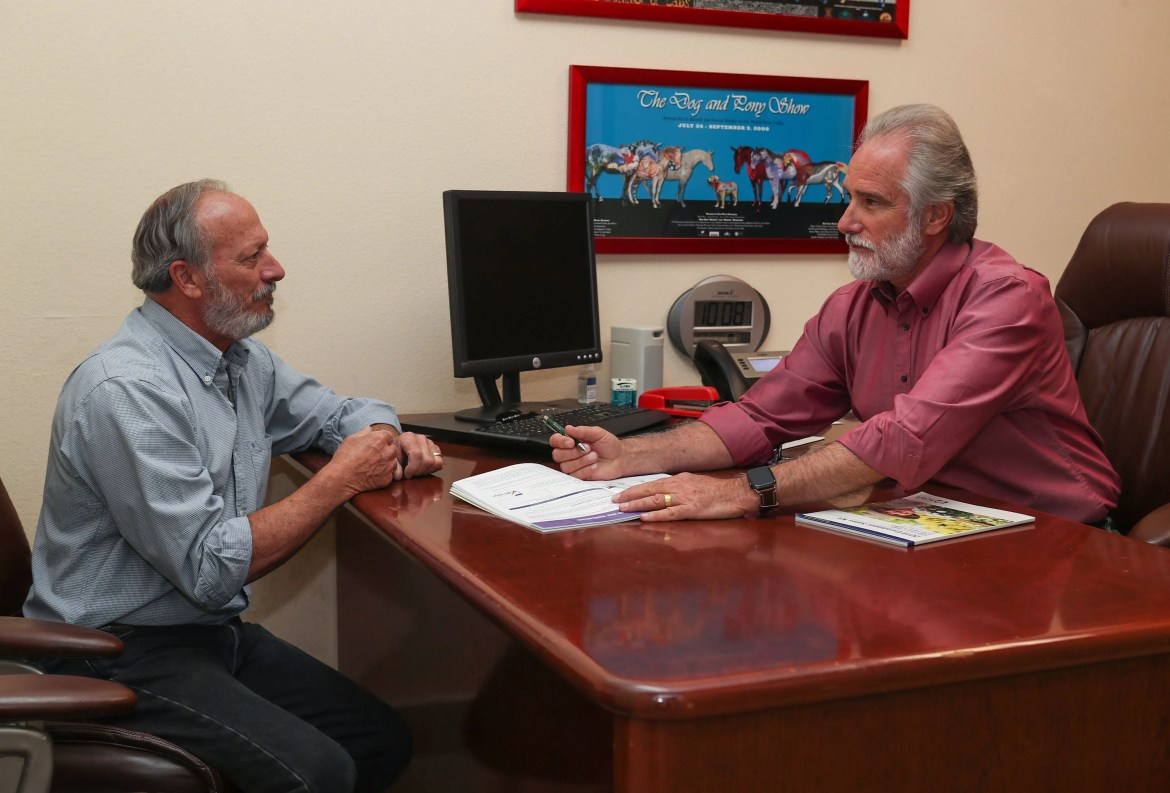 """Steve Isen, 64, consults with insurance agent Bill Youngblood.""""Medical insurance is what a mortgage used to be,"""" Isen says. """"I've been ignoring health issues -- like I have spinal stenosis and prostate problems that are catching up with me -- until I reach Medicare. I don't want to open the can of worms until I have better coverage."""""""