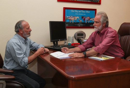 "Steve Isen, 64, consults with insurance agent Bill Youngblood. ""Medical insurance is what a mortgage used to be,"" Isen says. ""I've been ignoring health issues -- like I have spinal stenosis and prostate problems that are catching up with me -- until I reach Medicare. I don't want to open the can of worms until I have better coverage."""
