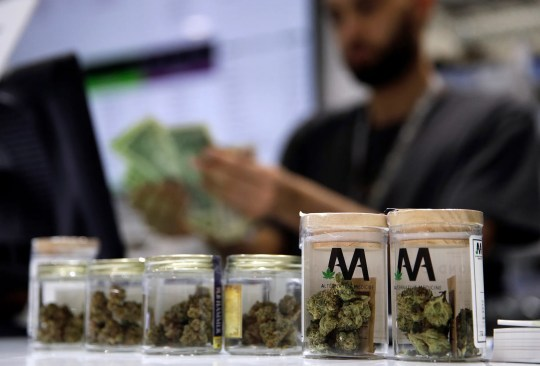 A cashier rings up a marijuana sale at a cannabis dispensary in Las Vegas on July 1, 2017.