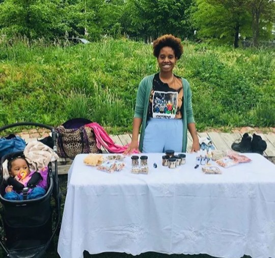 Claire Alcindor is shown selling her herbal skin care products at the Whitelock Community Farm in Baltimore, Md. Alcindor used marijuana to ease nausea and depression symptoms during the pregnancy.