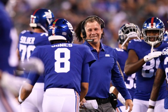New York Giants head coach Pat Shurmur smiles towards rookie quarterback Daniel Jones (8) after throwing his first touchdown in his NFL debut. The Jets face the Giants in the first preseason game at MetLife Stadium on Thursday, August 8, 2019, in East Rutherford.
