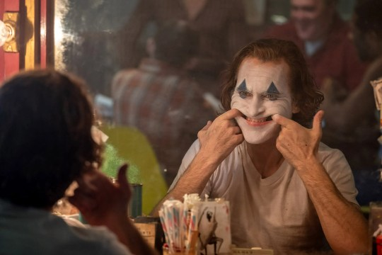 """Clown-for-hire and failed stand-up comedian Arthur Fleck (Joaquin Phoenix) goes down a tragic path of pure mayhem in """"Joker."""""""