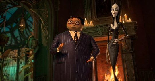 """Gomez (voiced by Oscar Isaac, left) and Morticia Addams (Charlize Theron) move their brood to New Jersey in the animated """"The Addams Family."""""""