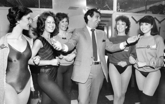 Domingo laughs with members of the Rockettes at New York's Radio City Music Hall in 1984.