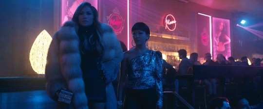 """Ramona (Jennifer Lopez, left) and Destiny (Constance Wu) are former strip-club employees who make ends meet in criminal fashion in """"Hustlers."""""""