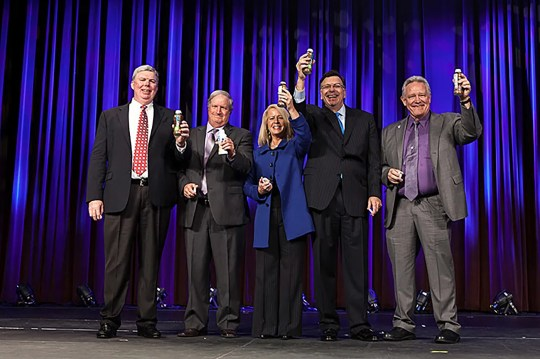 Thomas Gallagher, second from right, of Dairy Management Inc., is shown at a 2014 event announcing more than $500 million in partnerships with seven major companies.