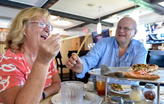 Kathy and Jack Krantz, of Port St. Lucie, have a few moments of fun with their pasta straws after dinner at Pappa Louie's Italian Restaurant with friend Tony Ferrino (not pictured) on Sunday, August 25, 2019, in Port St. Lucie.