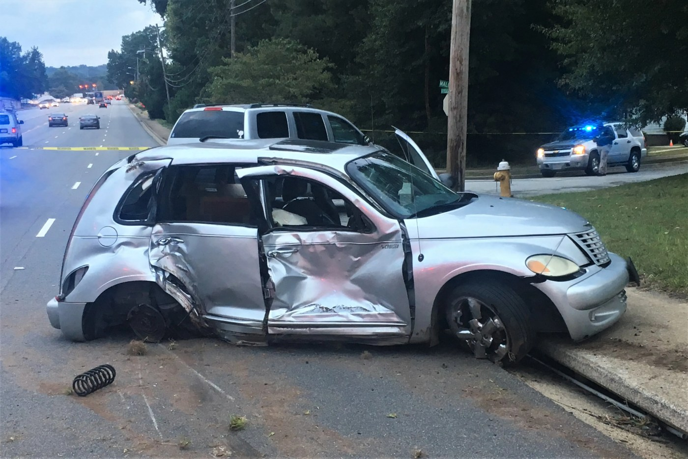 A Chrysler PT Cruiser police say struck a 13-year-old boy during a possible road rage incident sits at the scene of the wreck.