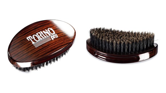 The Torino Pro Wave Brush is small enough to fit comfortably in your palm as you brush.