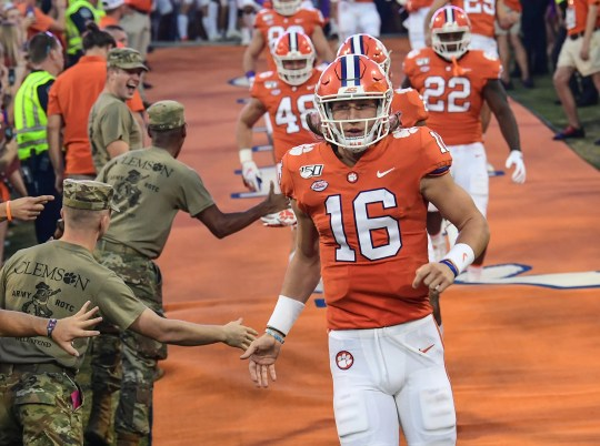 Clemson quarterback Trevor Lawrence (16) runs down the hill with teammates before the game at Memorial Stadium in Clemson, South Carolina Saturday, September 21, 2019.
