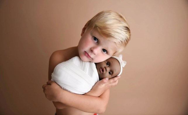Mom captures beautiful photos of her son with his baby doll. 'Toys do not have genders'