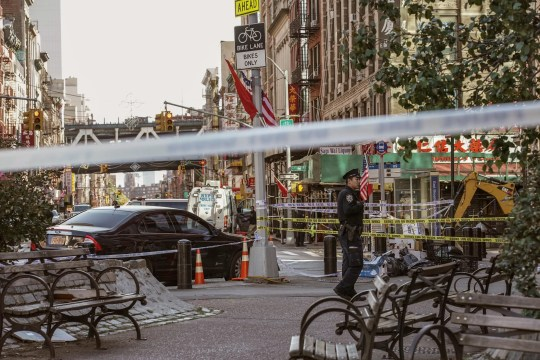 New York Police Department officers investigate the scene of an attack in Manhattan's Chinatown neighborhood, Saturday, Oct. 5, 2019 in New York.