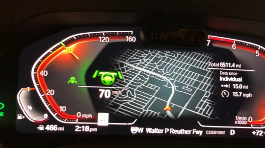 The handsome instrument cluster shows a map of the vicinity behind the gauges.