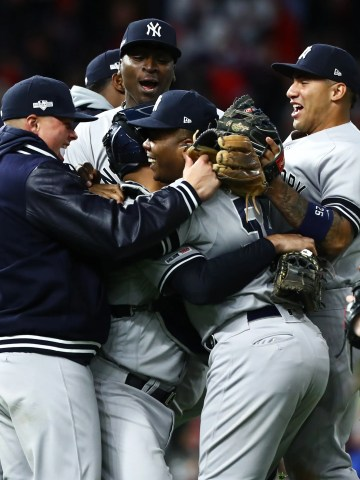 The Yankees celebrate after sweeping the Twins in the ALDS.