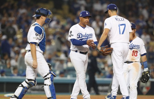 Los Angeles Dodgers manager Dave Roberts pulls Los Angeles Dodgers relief pitcher Joe Kelly after giving up a grand slam to Washington Nationals Howie Kendrick in the top of the 10th inning.