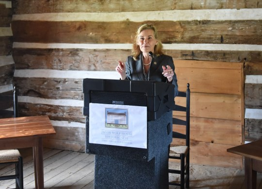 Stacy Hurst, secretary for the Arkansas Department of Parks, Heritage and Tourism, talks about the importance of the Jacob Wolf House during a dedication ceremony Friday for the site's new historical marker.
