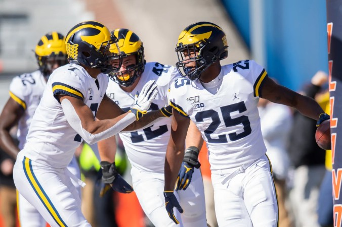 Oct 12, 2019; Champaign, IL, USA; Michigan Wolverines running back Hassan Haskins (25) celebrates his touchdown during the first half against the Illinois Fighting Illini at Memorial Stadium.