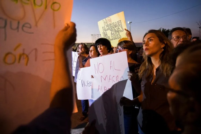 Residents of Mexicali, Mexico gather to protest the possible opening of a migrant shelter for MPP migrants from Central America who are waiting for a court hearing in the U.S. in order to seek asylum. The residents are worried about the migrants devaluing their property, possible violence and the safety of school age children.