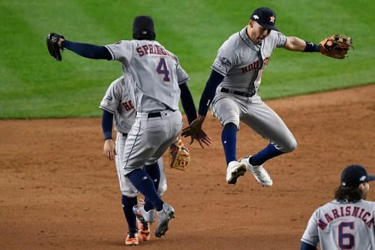 Astros center fielder George Springer and shortstop Carlos Correa celebrate after winning Game 4.