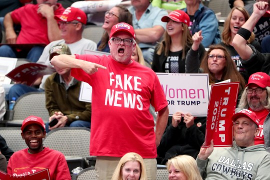 """Supporters react as U.S. President Donald Trump speaks during a """"Keep America Great"""" Campaign Rally at American Airlines Center on October 17, 2019 in Dallas, Texas."""